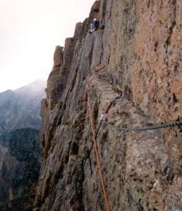 Joe sitting on the far end of Table Ledge, preparing to belay Brian to complete our escape from the East Face of Longs Peak