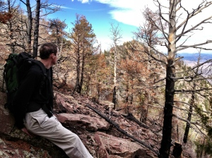 Brian resting on the edge of the burn zone from the 'Flagstaff Fire' of 6/2012. Bear Peak is visible in the distance.